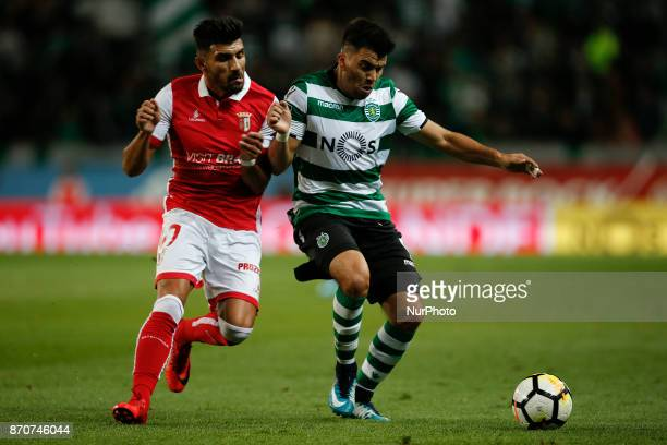 Braga's midfielder Ricardo Esgaio vies for the ball with Sporting's midfielder Marcos Acuna during Primeira Liga 2017/18 match between Sporting CP vs...