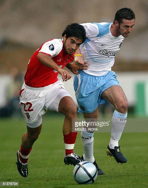 Braga's player Abel Moreira vies with Hearts FC's James McAllister during their Uefa Cup first round second leg football match at the Municipal...