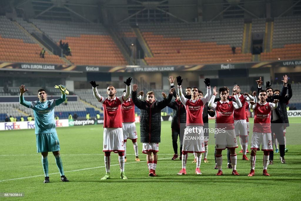 Braga's players acknowledge their supporters after losing the UEFA Europa League Group C football match between Istanbul Basaksehir FK and SC Braga at the Fatih Terim Stadium in Istanbul, on December 7, 2017. /