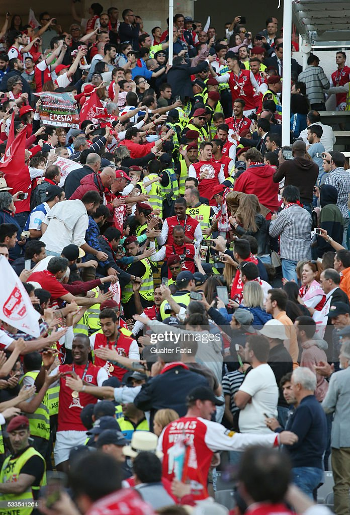 SC Braga's players celebrate with supporters winning the Portuguese Cup Title at the end of the Portuguese Cup Final match between FC Porto and SC Braga at Estadio Nacional on May 22, 2016 in Lisbon, Portugal.