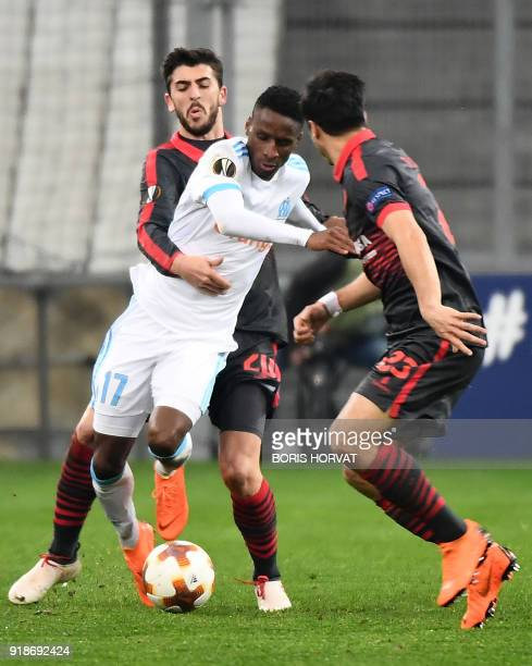 SC Braga's Portugese forward Joao Paulo Fernandes and SC Braga's Portugese midfielder Joao Carlos Teixeira fight for the ball with Olympique de...