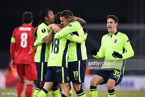 Braga's Portugese forward Rafa Silva celebrates with teammates after scoring during the UEFA Europa League round of 32 first leg football match...