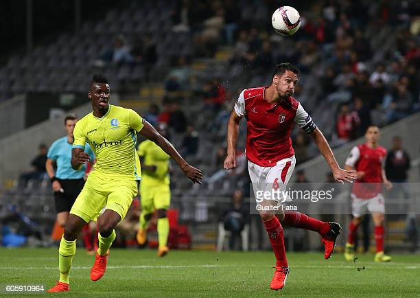 Braga's Portuguese defender Andre Pinto with Gent's forward Kalifa Coulibaly from Mali in action during the UEFA Europa League match between SC Braga...