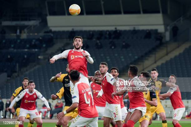 Braga's Portuguese forward Paulinho heads the ball during the UEFA Europa League Group G football match between AEK Athens and Sporting Braga, at The...