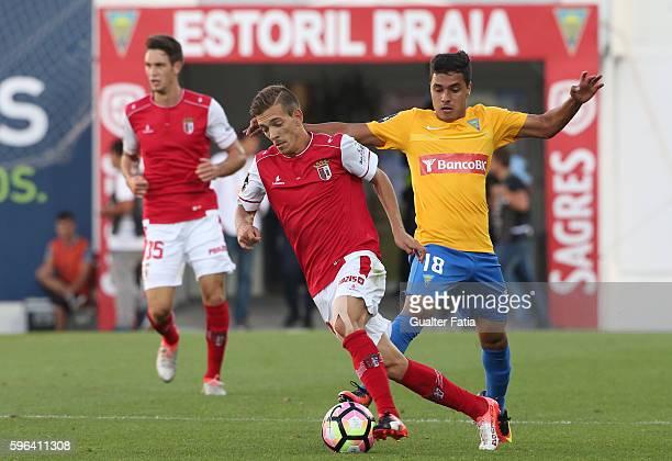Braga's Portuguese forward Pedro Santos with Estoril's forward Alisson Farias from Brazil in action during the Primeira Liga match between GD Estoril...
