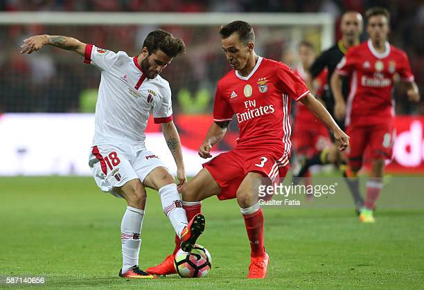 Braga's Portuguese forward Rafa Silva with SL Benfica's defender from Spain Alex Grimaldo in action during the Super Cup match between SL Benfica and...