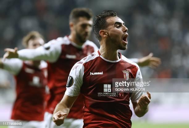 Braga's Portuguese forward Ricardo Horta celebrates after scoring the opening goal with Portuguese forward Paulinho during the UEFA Europa League...