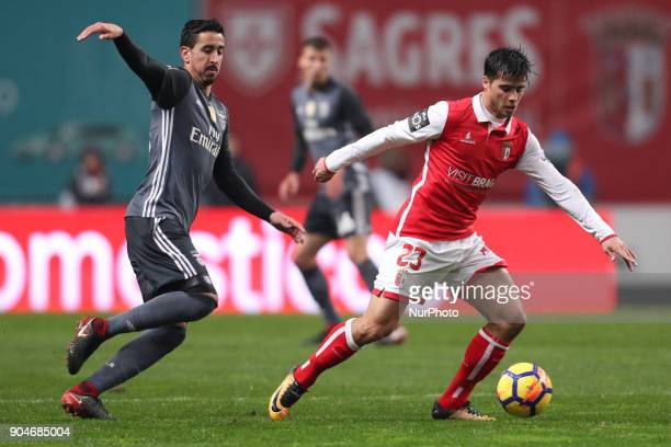 Braga's Portuguese midfielder Joao Carlos Teixeira in action with Benfica's Portuguese defender Andre Almeida during the Premier League 2017/18 match...