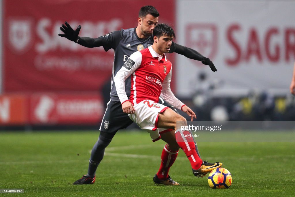 Braga's Portuguese midfielder Joao Carlos Teixeira (R) vies with BBenfica's Greek midfielder Andreas Samaris (L) during the Premier League 2017/18 match between SC Braga and SL Benfica, at Municipal de Braga Stadium in Braga on January 13, 2018.