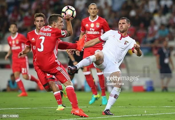 Braga's Serbian forward Nikola Stojiljkovic with SL Benfica's defender from Spain Alex Grimaldo in action during the Super Cup match between SL...