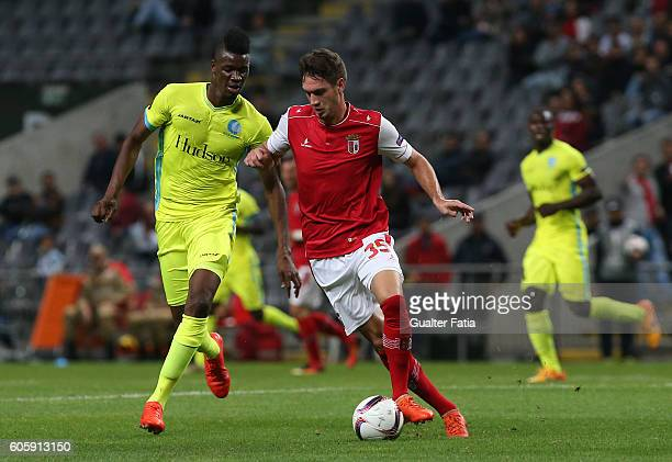 Braga's Serbian midfielder Nikola Vukcevic with Gent«s forward Kalifa Coulibaly from Mali in action during the UEFA Europa League match between SC...