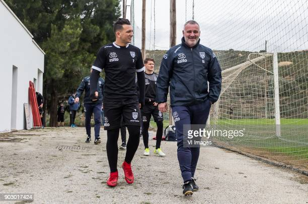 Brahim Darri of Heracles Almelo assistent trainer Rob Alflen of Heracles Almelo during a training session of Heracles Almelo at the Don Julia resort...