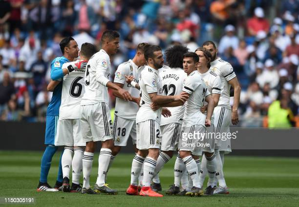 Brahim Diaz and Dani Carvajal of Real Madrid look on with teammates before the La Liga match between Real Madrid CF and Real Betis Balompie at...