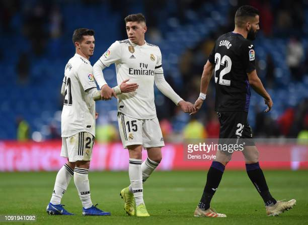 Brahim Diaz and Federico Valverde of Real Madrid CF react beside Dimitrios Siovas of CD Leganes at the end of the Copa del Rey Round of 16 match...