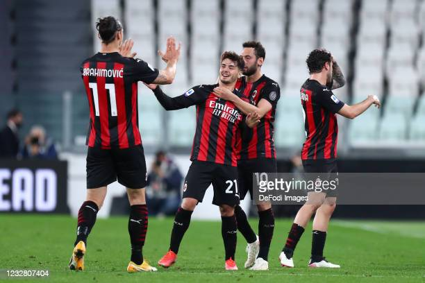 Brahim Diaz of AC Milan celebrates after scoring his team's first goal with team mates during the Serie A match between Juventus and AC Milan at on...