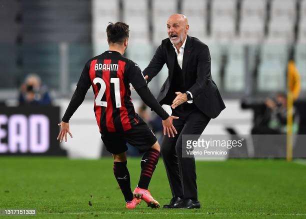 Brahim Diaz of A.C. Milan celebrates with Stefano Pioli after scoring their side's first goal during the Serie A match between Juventus and AC Milan...