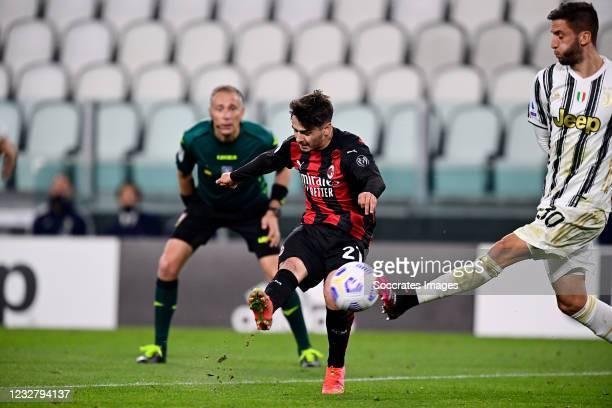 Brahim Diaz of AC Milan scores the first goal to make it 0-1, Rodrigo Bentancur of Juventus during the Italian Serie A match between Juventus v AC...