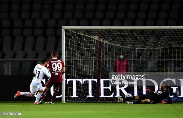 Brahim Diaz of A.C. Milan scores their side's fourth goal pat Salvatore Sirigu of Torino FC during the Serie A match between Torino FC and AC Milan...