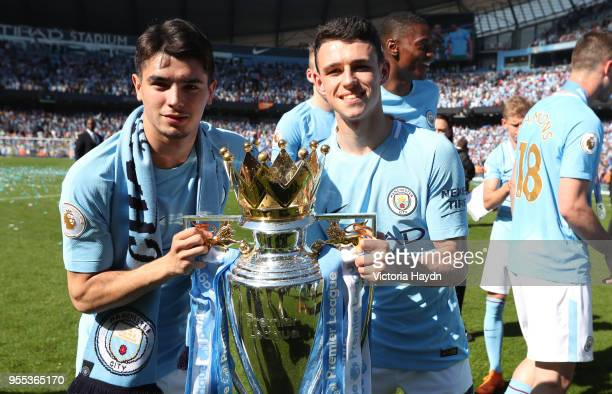 Brahim Diaz of Manchester City and Phil Foden of Manchester City celebrate with The Premier League Trophy after the Premier League match between...