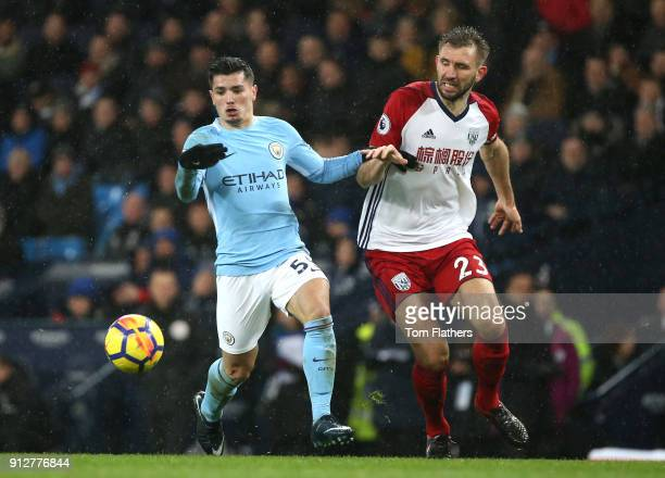 Brahim Diaz of Manchester City battles for possesion with Gareth McAuley of West Bromwich Albion during the Premier League match between Manchester...