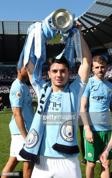 Brahim Diaz of Manchester City celebrate with The Premier League Trophy after the Premier League match between Manchester City and Huddersfield Town...