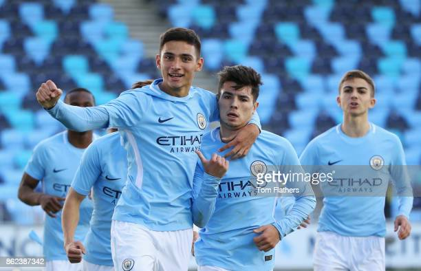 Brahim Diaz of Manchester City celebrates with team mate Nabil Touaizi Zoubdi of Manchester City as he scores their first goal during the UEFA Youth...