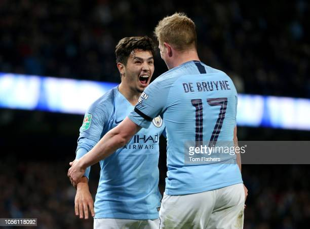 Brahim Diaz of Manchester City celebrates with teammate Kevin De Bruyne after scoring his team's second goal during the Carabao Cup Fourth Round...