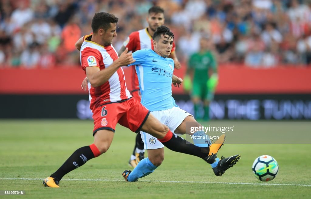 Brahim Diaz of Manchester City competes with Alex Granell of Girona during the pre-season friendly match between Girona and Manchester City at Municipal de Montilivi Stadium on August 15, 2017 in Girona, Spain.