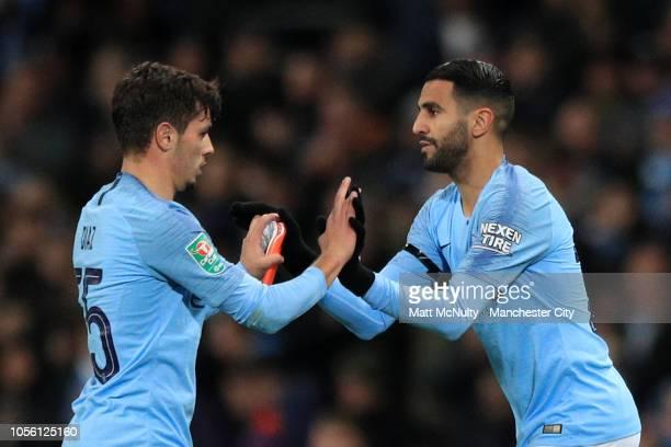 Brahim Diaz of Manchester City greets Riyad Mahrez of Manchester City as Brahim Diaz is substituted off and Riyad Mahrez is substituted on during the...