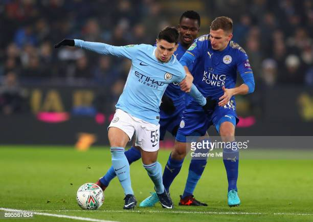 Brahim Diaz of Manchester City holds off Daniel Amartey and Marc Albrighton of Leicester City during the Carabao Cup QuarterFinal match between...