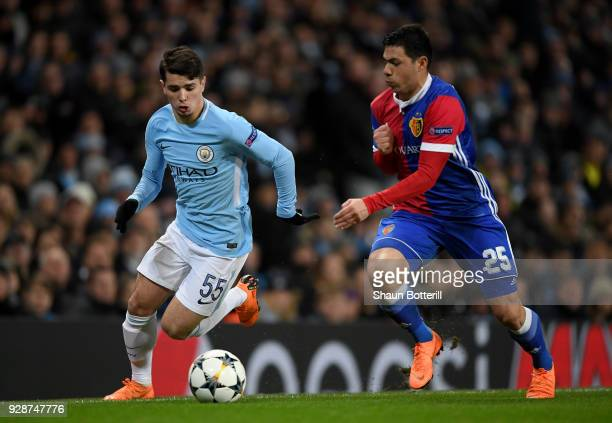 Brahim Diaz of Manchester City holds off pressure from Blas Riveros of FC Basel during the UEFA Champions League Round of 16 Second Leg match between...