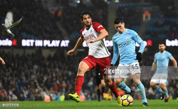 Brahim Diaz of Manchester City is challenged by Ahmed ElSayed Hegazi of West Bromwich Albion during the Premier League match between Manchester City...