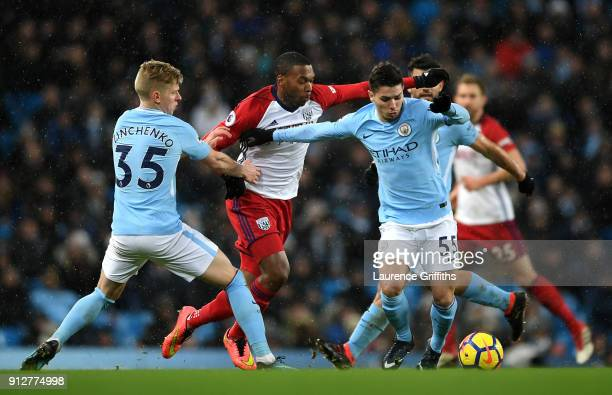 Brahim Diaz of Manchester City is challenged by Daniel Sturridge of West Bromwich Albion during the Premier League match between Manchester City and...