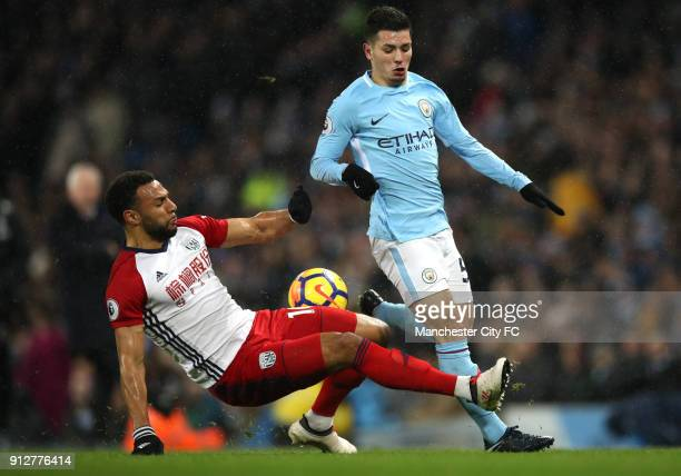 Brahim Diaz of Manchester City is tackled by Matt Phillips of West Bromwich Albion during the Premier League match between Manchester City and West...