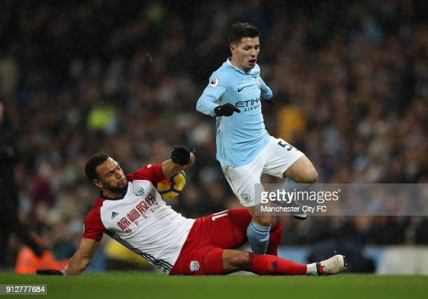 Brahim Diaz of Manchester City is tackled Matt Phillips of West Bromwich Albion during the Premier League match between Manchester City and West...