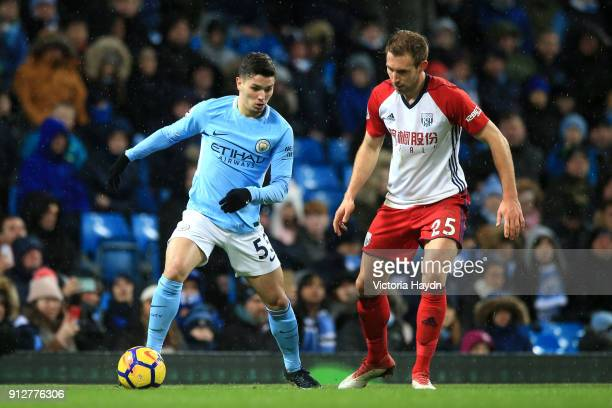 Brahim Diaz of Manchester City runs with the ball under pressure from Craig Dawson of West Bromwich Albion during the Premier League match between...