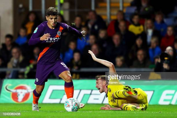 Brahim Diaz of Manchester City takes the ball past Sam Long of Oxford United during the Carabao Cup Third Round match between Oxford United and...