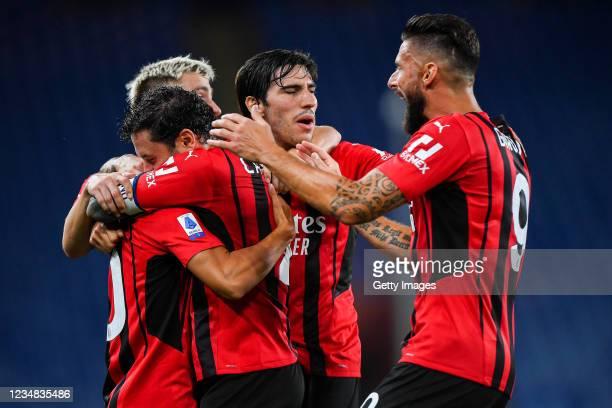 Brahim Diaz of Milan celebrates with his team-mates Davide Calabria, Alexis Saelemaekers, Sandro Tonali and Olivier Giroud after scoring a goal...