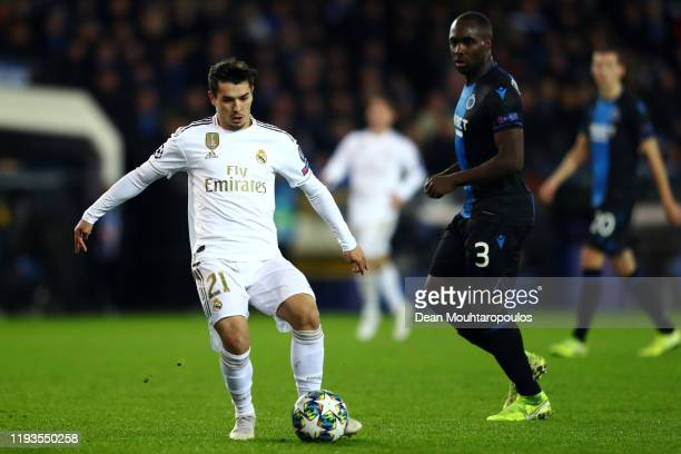 Brahim Diaz of Real Madrid battles for the ball with Eder Alvarez Balanta of Club Brugge KV during the UEFA Champions League group A match between...
