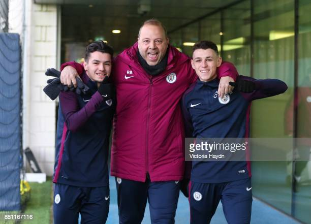Brahim Diaz Rodolfo Borrell and Phil Foden react as they walk to training at Manchester City Football Academy on November 28 2017 in Manchester...