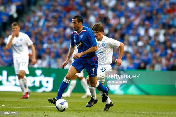 Brahim Hemdani of Glasgow and Andrei Arshavin of Zenit during the UEFA Cup Final match between Zenit Saint Petersburg and Rangers at City of...