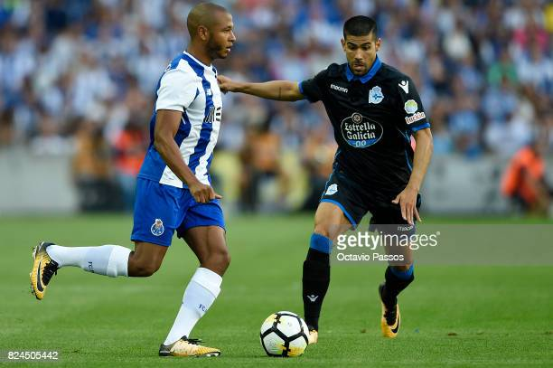 Brahimi of FC Porto competes for the ball with Juanfran of RC Deportivo La Coruna during the PreSeason Friendly match between FC Porto and RC...