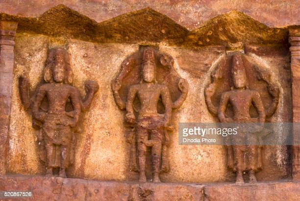 brahma, shiva and vishnu bas relief in cave temple 7th century, badami, karnataka, india - シバ神 ストックフォトと画像
