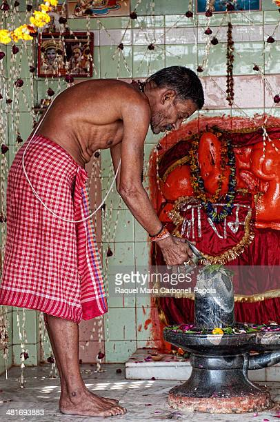 Brahmin performing puja ceremony in a temple on the ghats.
