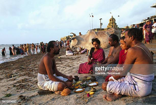 brahmins on the beach near the ramanathaswamy temple - brahmin stock pictures, royalty-free photos & images