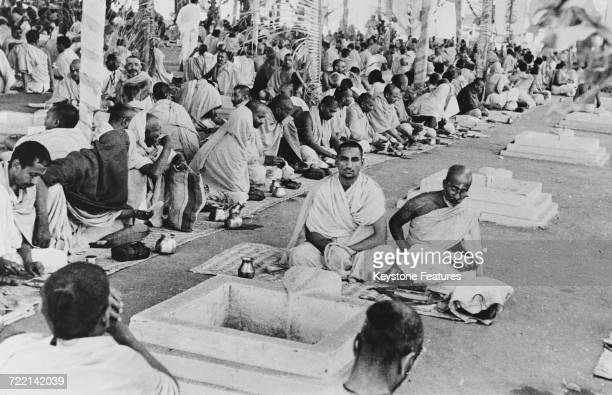 Brahmins reciting Vedic hymns by a sacred fire at a Hindu ceremony of prayer for world peace in Mumbai India February 1947 One hundred fires are kept...