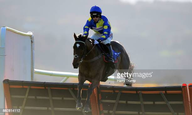 Brahms De Clermont ridden by Harry Cobden jump the last on their way to winning the Bet Toteplacepot At Betfredcom National Hnut Novices Hurdle at...