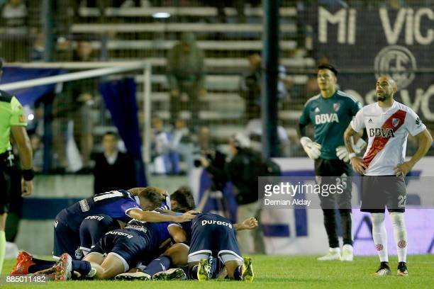 Braian Aleman of Gimnasia y Esgrima celebrates with teammates after scoring the second goal of his team during a match between Gimnasia y Esgrima La...