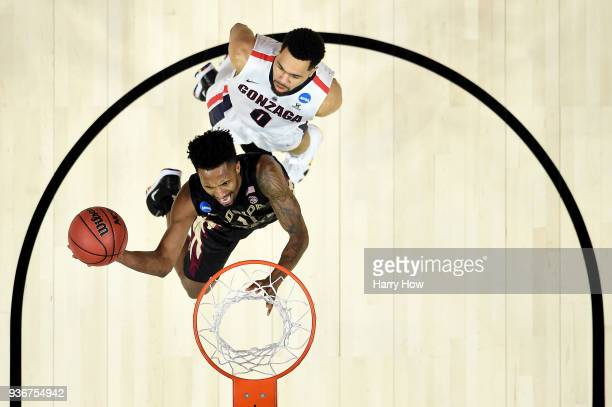 Braian Angola of the Florida State Seminoles goes up for a shot ahead of Silas Melson of the Gonzaga Bulldogs in the 2018 NCAA Men's Basketball...