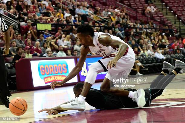 Braian AngolaRodas guard Florida State University Seminoles and Jakari Bush guard Thomas University Night Hawks hustle fot a loose basketball in an...